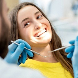 smiling woman dentist checkup