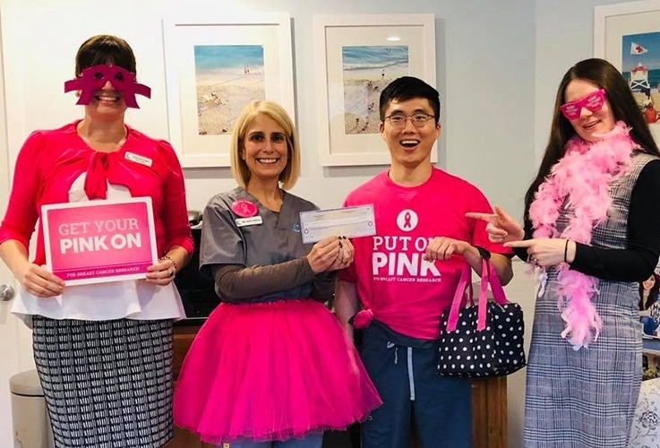 Team members celebrating breast cancer awareness month