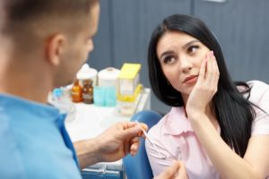 woman tooth pain dentist