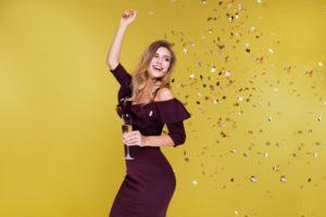woman smiling confetti