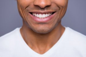 man smiling after a smile makeover