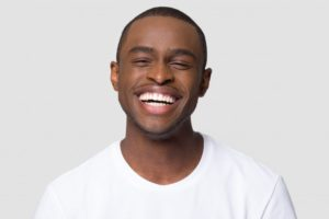 smiling man with dental implants in Westhampton