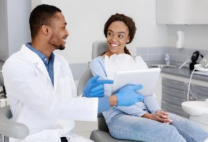 patient talking with a dentist in a dental implant consultation